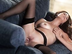 Gorgeous Curly Dark Haired Female Jamie Lynn Lounging On The Couch In Hot Underwear And Passionately Fondling Herself.