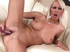 Blonde Vixen Pamela M With Large Tits Has Fire In Her Eyes As She Bangs Herself With Fuck Stick